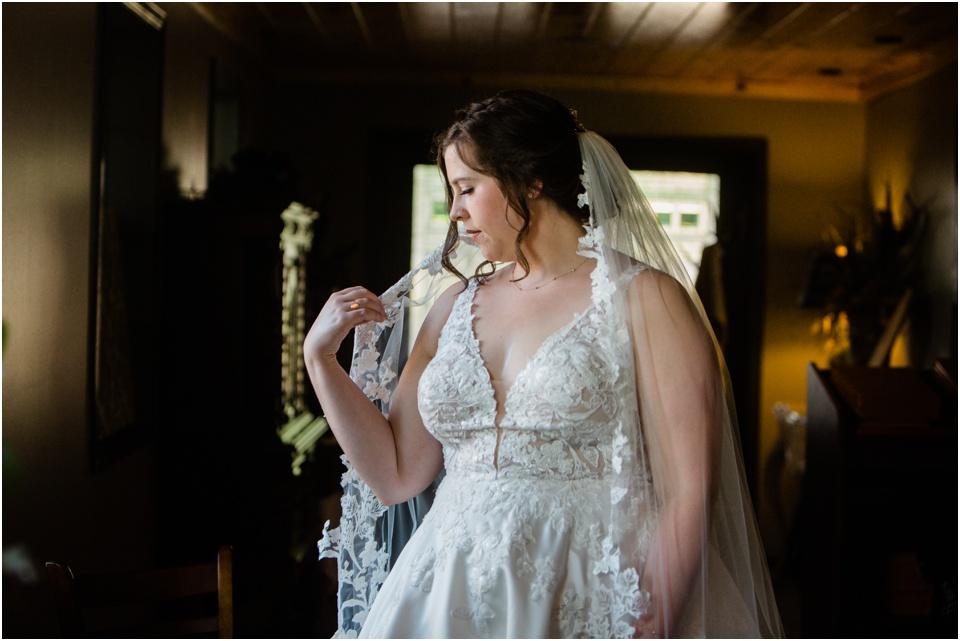 Bride fixing her veil